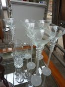 Six tall champagne glasses and a cut glass jug