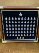 Framed and glazed Danbury mint badges of the squadrons of the air force