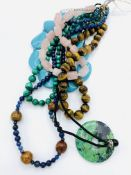 Six assorted gemstone necklaces