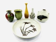 Five various art pottery vases and a shallow bowl