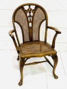Late Victorian open armchair with cane seat and back