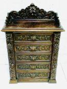 Ornately carved Continental oak 5 drawer Wellington chest
