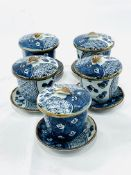 Five blue glazed Oriental ceramic lidded pots on dishes
