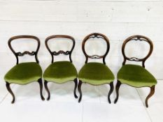 Two pairs of Victorian balloon back mahogany dining chairs