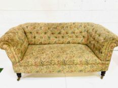 A floral upholstered button back Chesterfield sofa