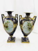 A pair of blue and gilt hand decorated Japanese vases