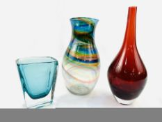 A hand blown swirl coloured glass vase, a red glass vase, and a blue glass vase