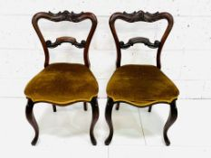A pair of Victorian mahogany dining chairs