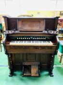 Peerless organ by Foley and Williams Manufacturing Company