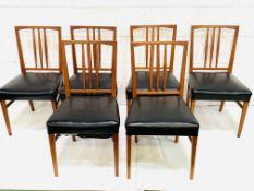A group of 6 teak framed rail back chairs