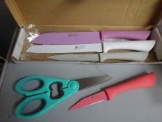 Four piece knife set with scissors.