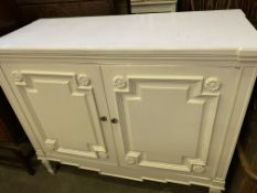 White painted wooden two door cupboard