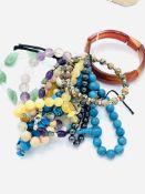 Ten various gemstone bracelets.