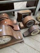 Six various mantel clocks.