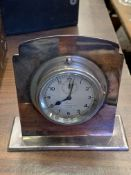 An 8 day car clock by S. Smith and Sons Limited