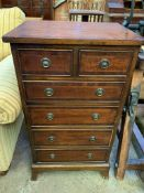 A small mahogany chest of two over four graduated drawers