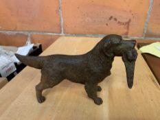 Cast metal figure of a Retriever with pheasant