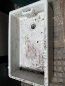 A white glazed stoneware Belfast sink