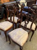 A group of two mahogany framed carvers and two mahogany framed chairs