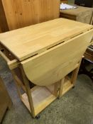 Laminated wood drop down gate leg table on casters