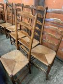Six oak framed high ladder back chairs with string seats