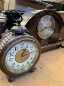 Four various mantel clocks; together with a mahogany cased early alarm clock and a banjo barometer