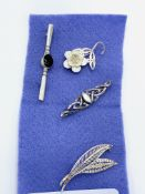 Two silver brooches and three other various brooches