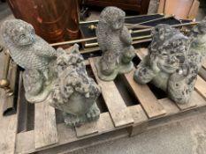 Four concrete garden ornaments