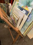 Wooden stand containing a quantity of unframed watercolours of various subjects, Fiona Goldbacher