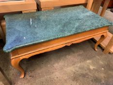 A wood framed coffee table with green marble top