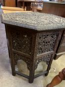 Octagonal table with African style carvings to the top