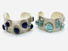 Two white metal bangles set with turquoise gemstones and purple gemstones