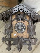 Black Forest clock and two boxes of various clock parts