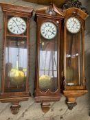 Three mahogany cased wall clocks.
