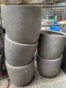 Five round stone-effect fibreglass planters