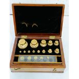 Boxed set of brass standard troy weights, County of Wilts, De Grave & Co