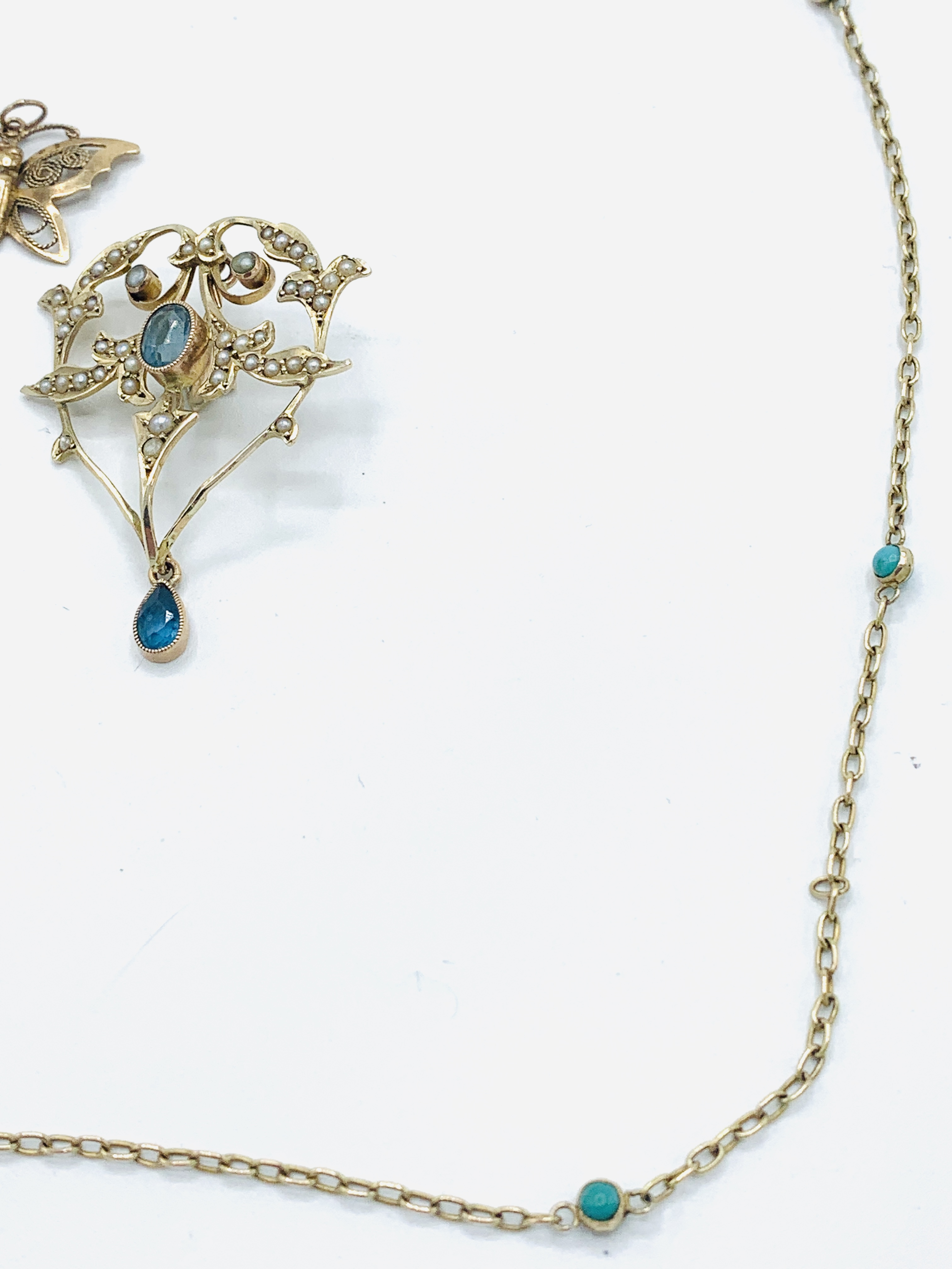 9ct gold aquamarine and seed pearl pendant; gold and turquoise chain; gold cross; butterfly brooch - Image 4 of 5