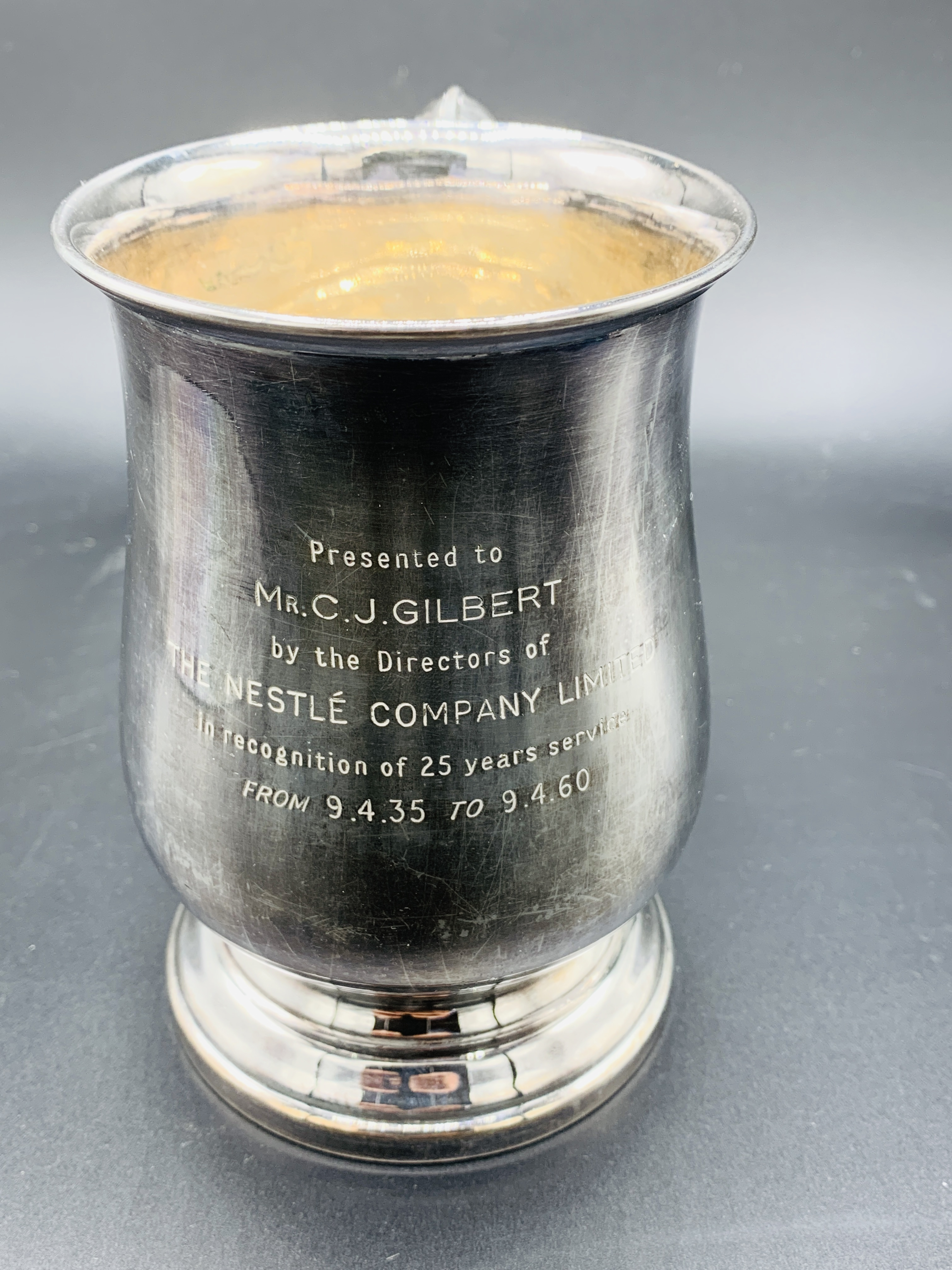 Silver tankard hallmarked Sheffield 1960; together with a silver trophy on Bakelite stand