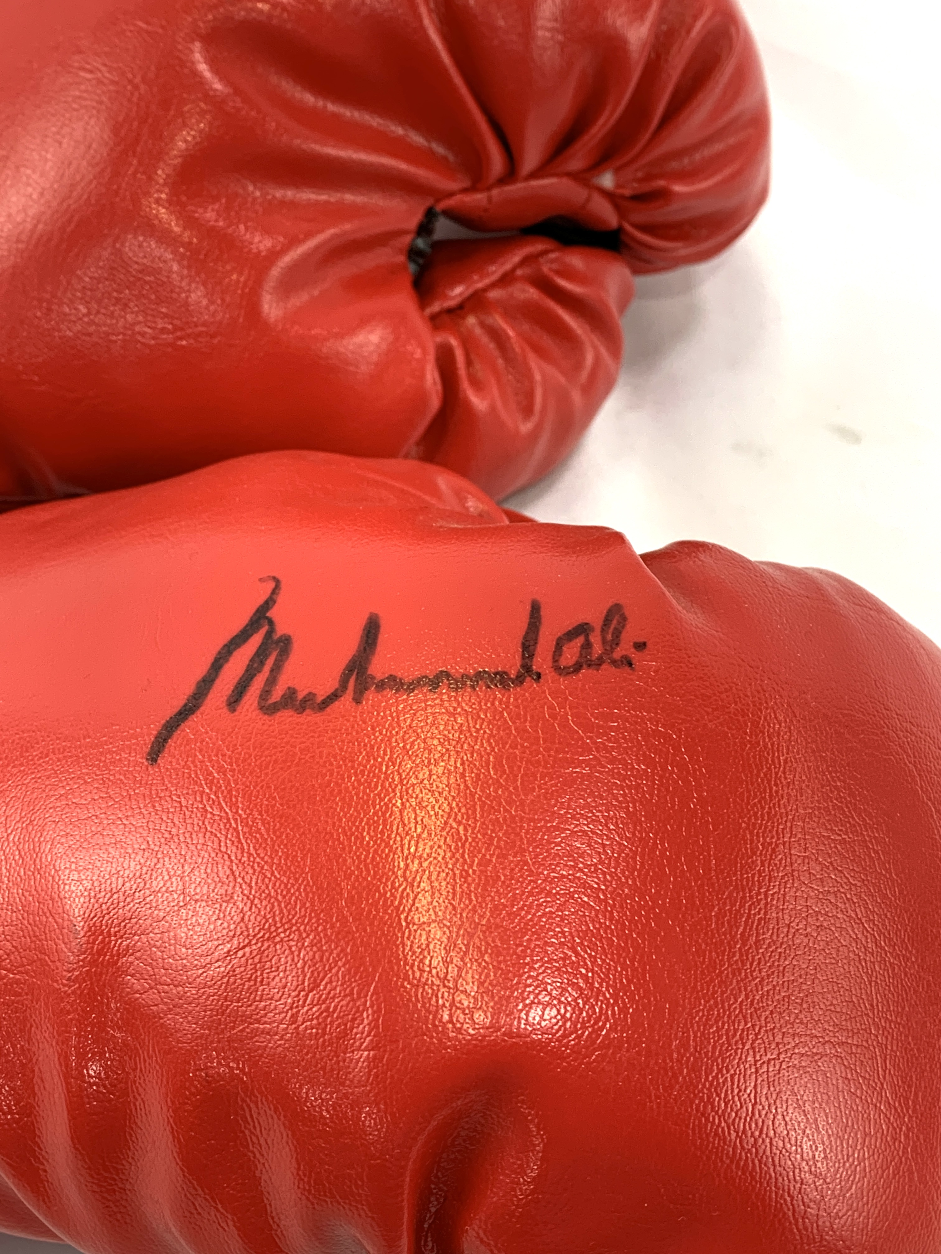 Pair of red Everlast boxing gloves, one signed Muhammad Ali - Image 2 of 2