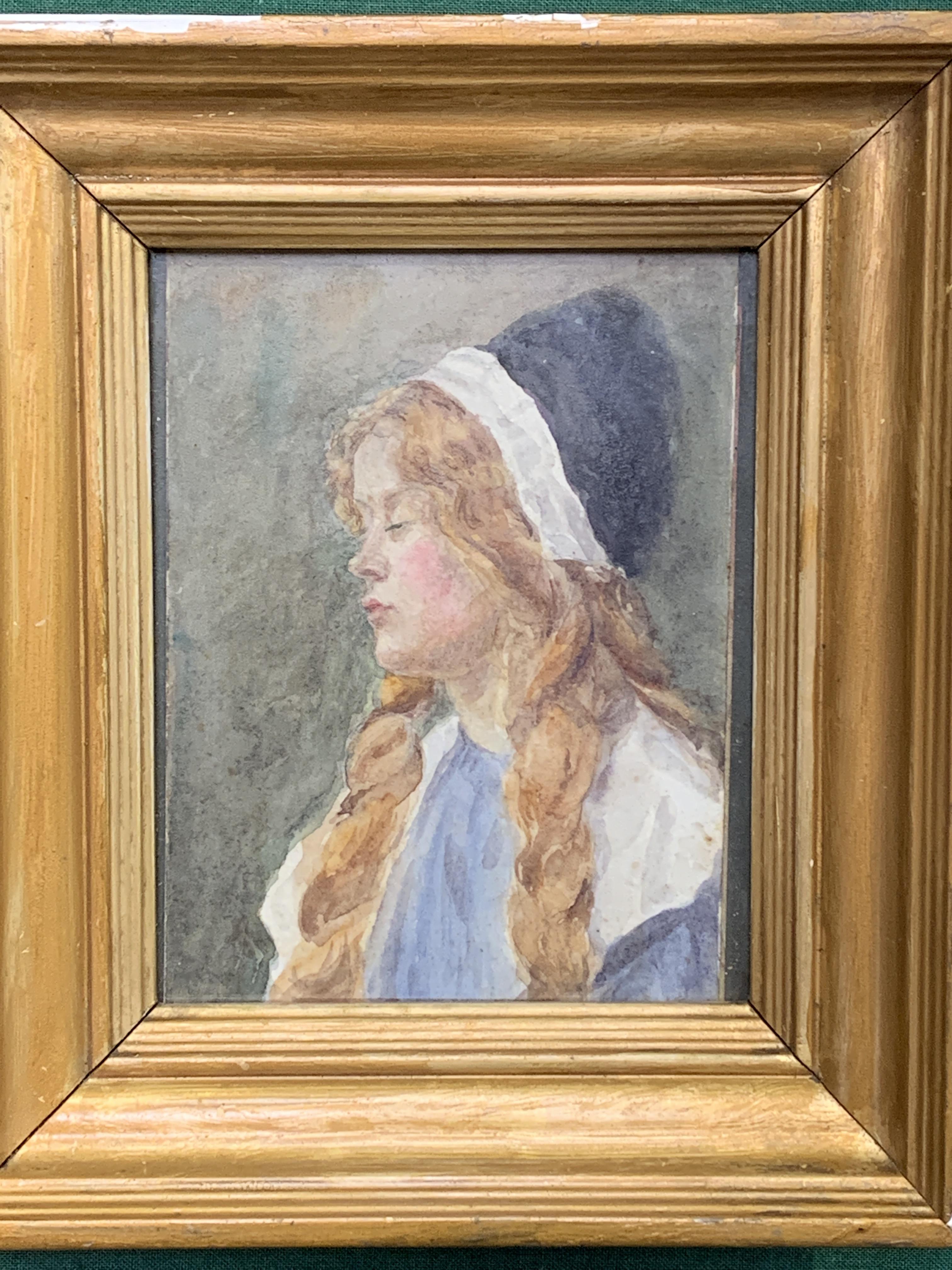 A small gilt framed watercolour of a girl