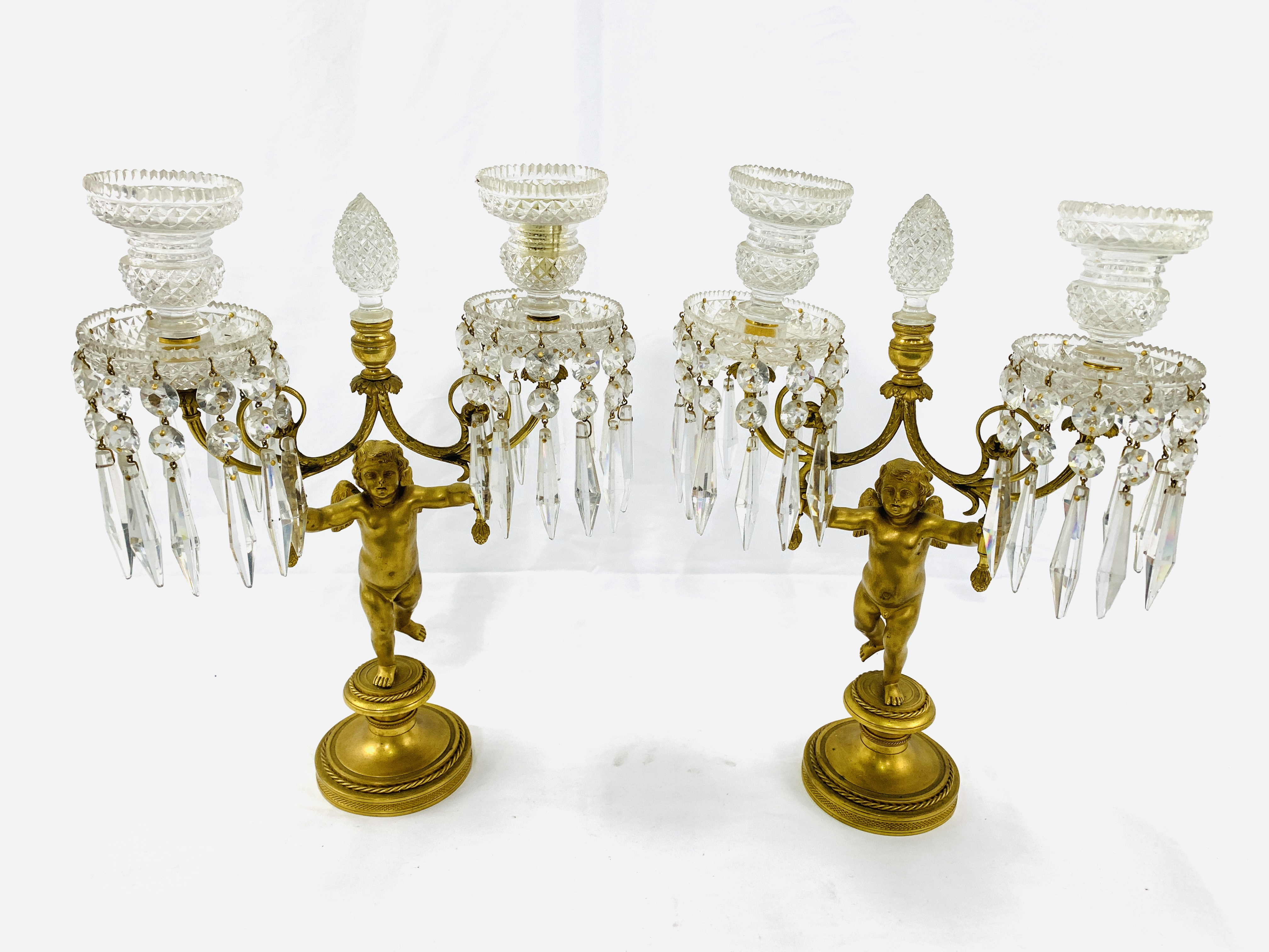 A pair of early 19th Century figural putti gilt bronze and crystal glass candelabra - Image 2 of 4