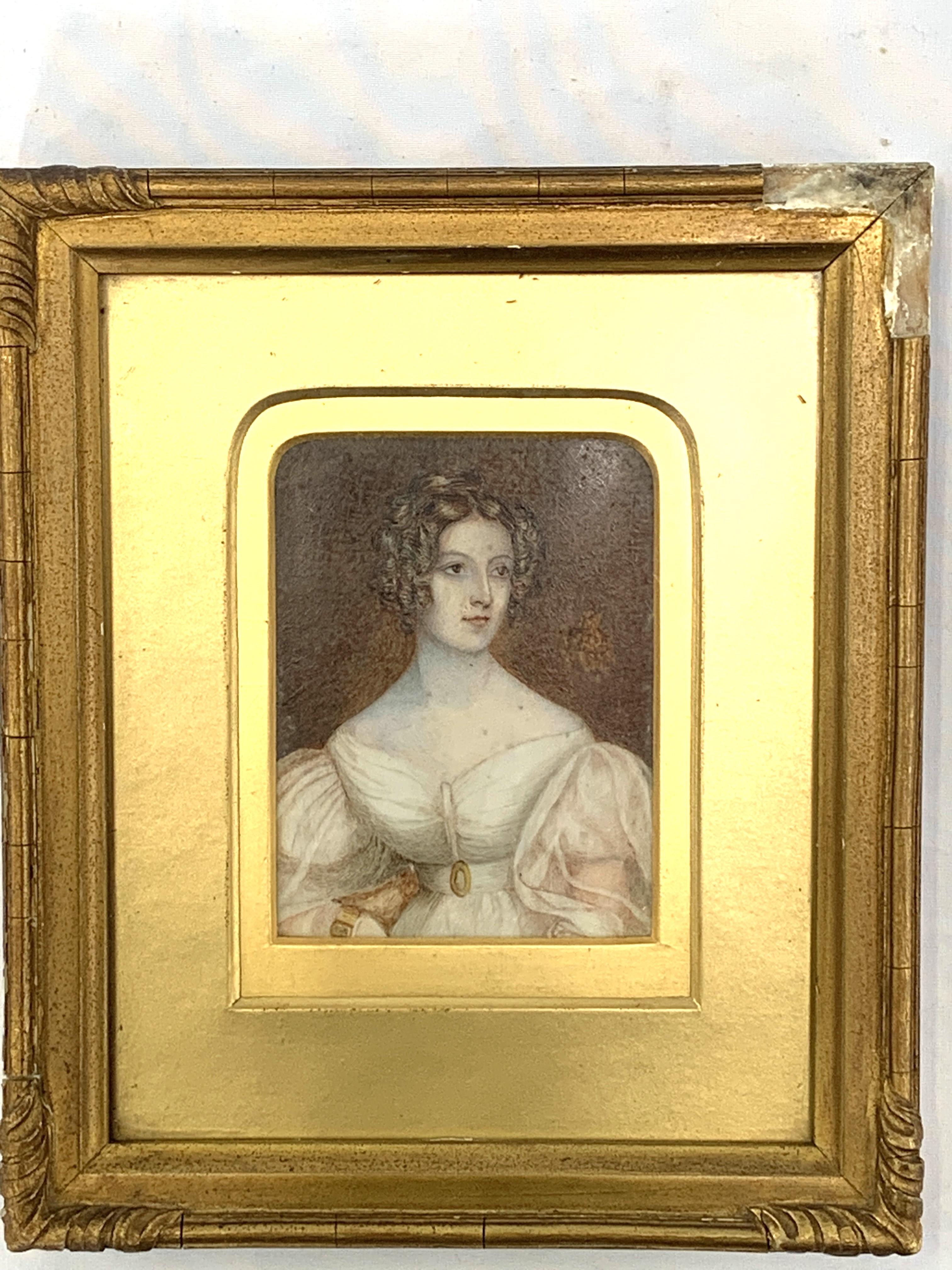 Gilt framed and glazed miniature oil portrait of a lady