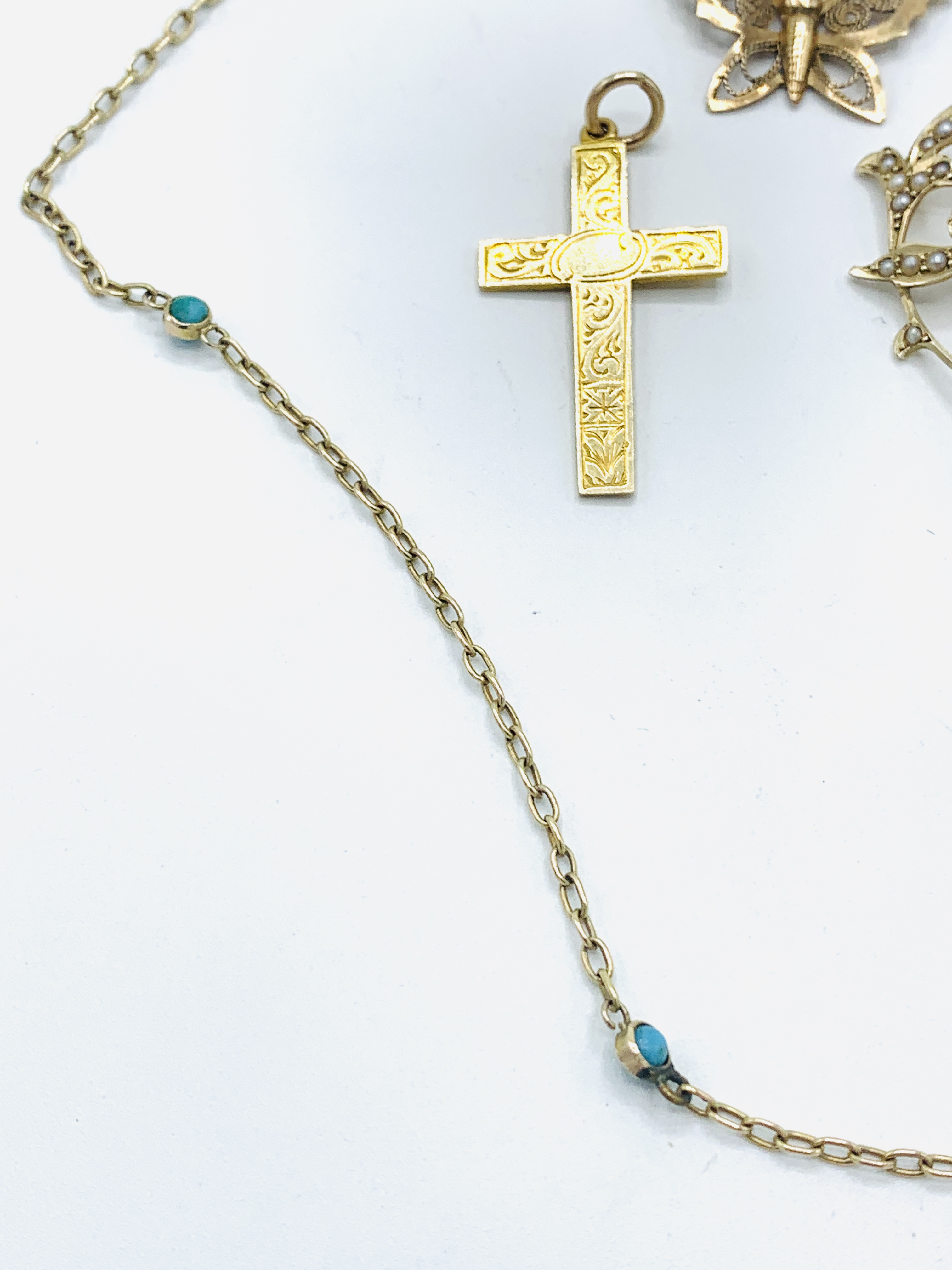 9ct gold aquamarine and seed pearl pendant; gold and turquoise chain; gold cross; butterfly brooch - Image 3 of 5