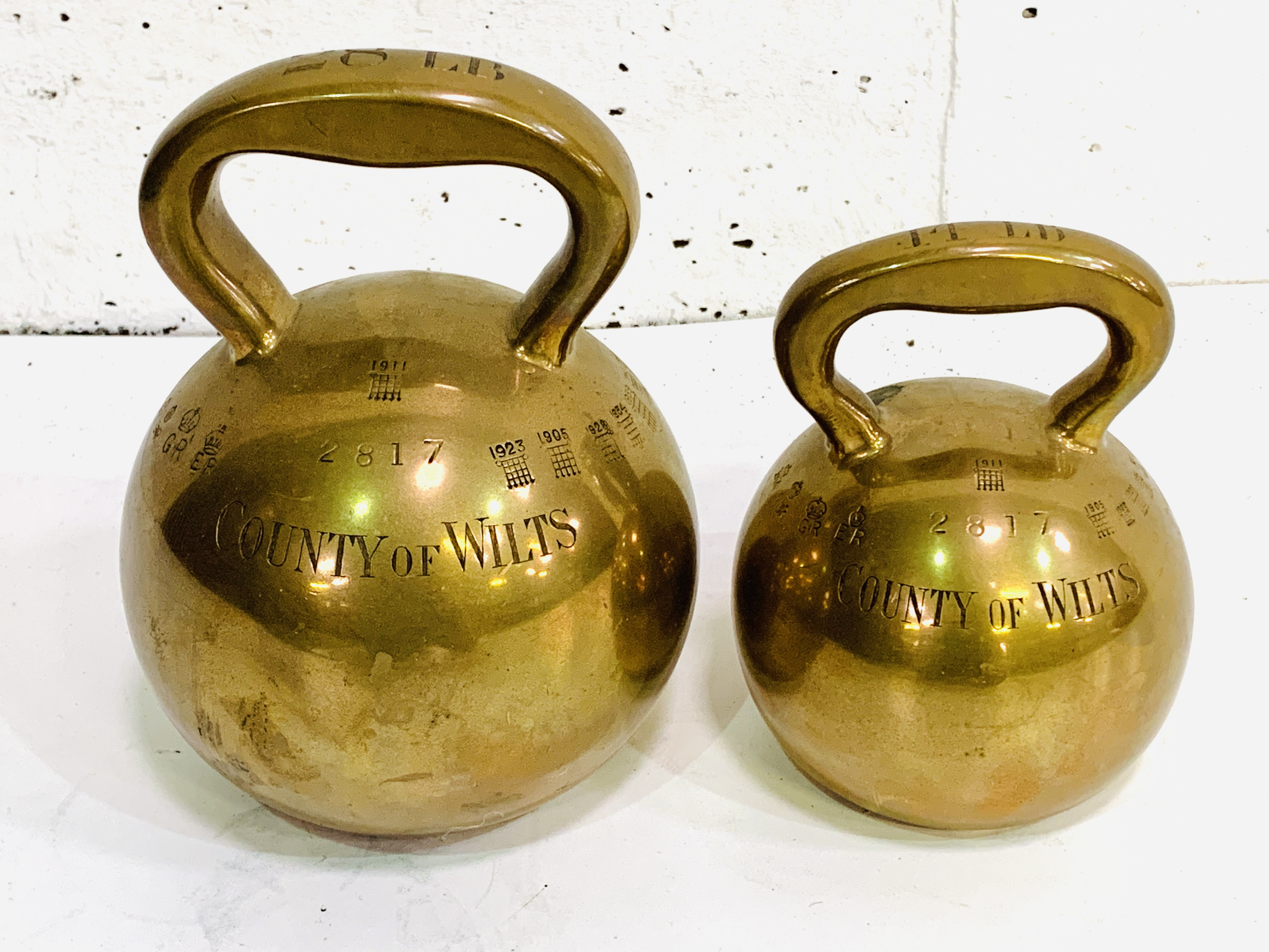 Two brass County of Wilts bell weights