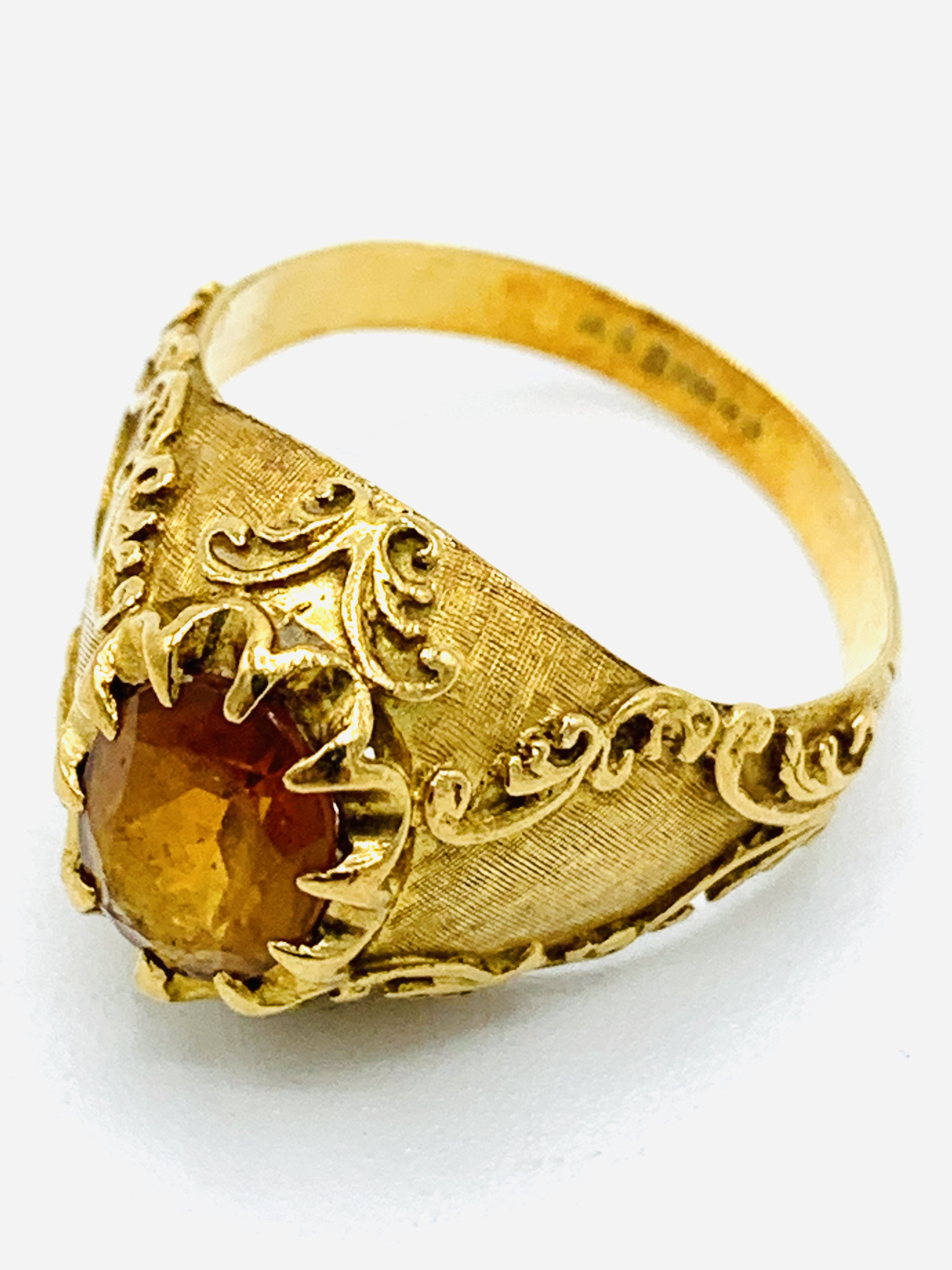 18ct gold and citrine ring and a yellow metal and yellow stone ring