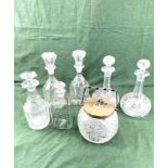 A pair of Victorian decanters, a pair of Edwardian decanters, a cut glass biscuit barrel