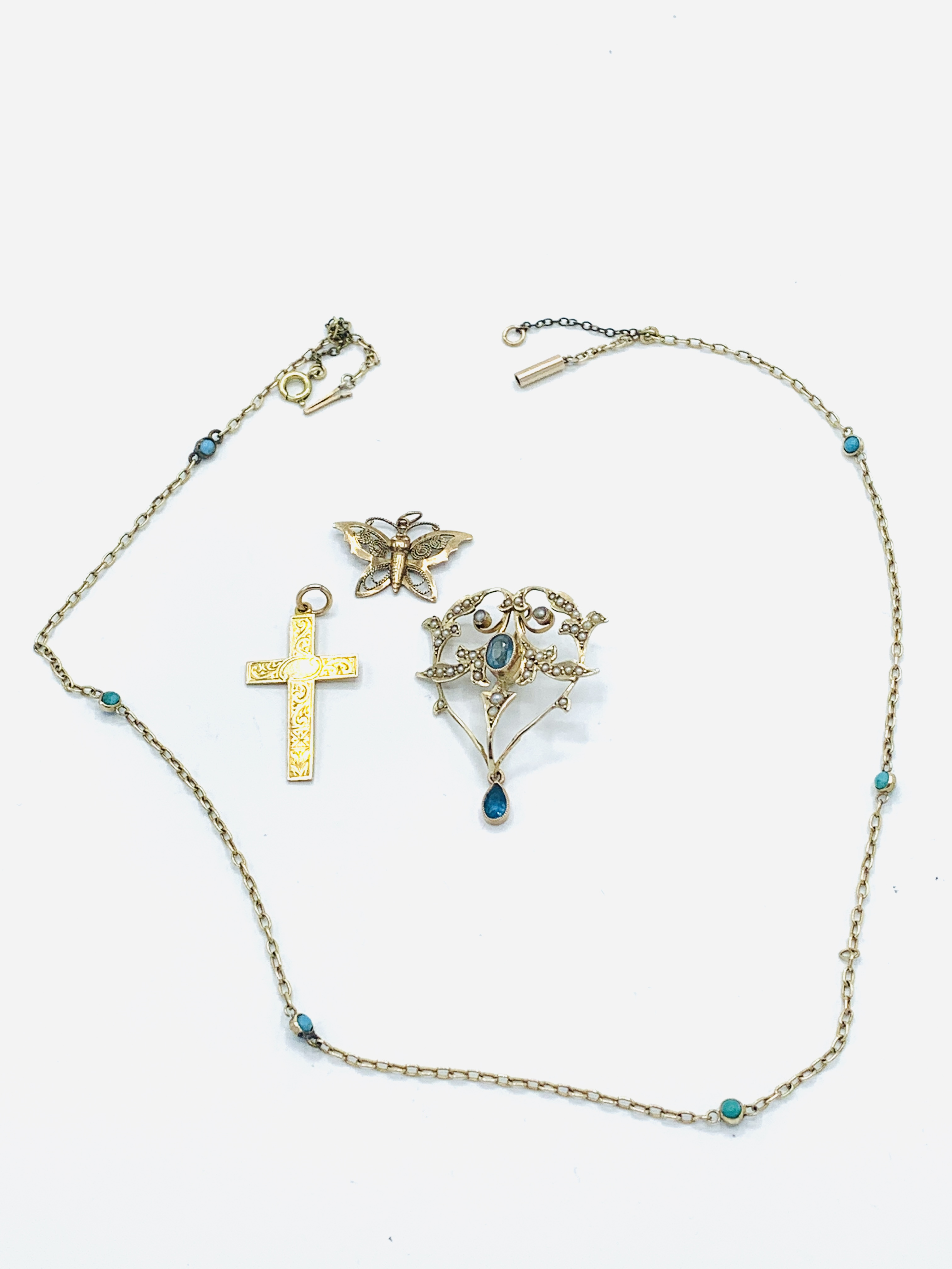 9ct gold aquamarine and seed pearl pendant; gold and turquoise chain; gold cross; butterfly brooch