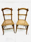 Pair of decorative cane seat arched back bedroom chairs
