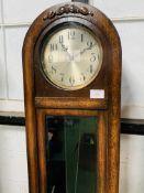 A 1930's style oak dome topped long case clock
