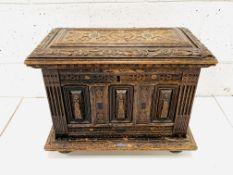 Carved oak casket with ebony inserts